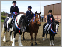 Left to Right: Victoria Robinson and Marble as Champion and Reserve, Robyn Wrigley and Ben Reserve Champion, and Hannah Bowles and Nugget - Champion.